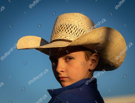 Larron Cook, winner of the 11 and under whip crack, looks on during the 71st annual Harts Range Races and Rodeo, approximately 215 km East of Alice Springs, Northern Territory, Australia, 04 August 2018 (issued 05 August 2018). Cut out of the bush of Mt. Riddock Station by The Webb brothers, The Harts Range track has been a mainstay of the Central Australian Pastoral communities since 1947. Unregistered station horses, local ringers, mounted police and Atitjere community members race, rodeo and revel in the bush skills they use every day with most of the money generated going to charity.