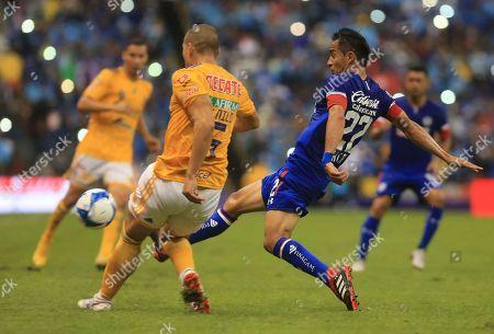 Javier Aquino, Gerardo Floes. Tigres' Emmanuel Torres, left, fights for the ball with Cruz Azul's Rafael Baca during a Mexico soccer league match in Mexico City