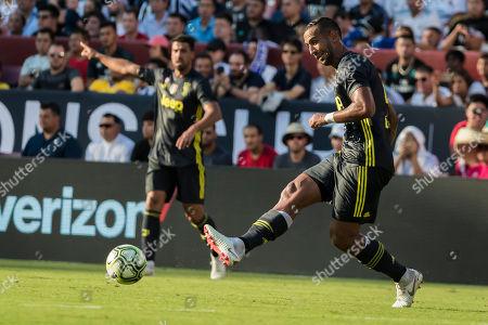 Juventus defender Mehdi Benatia (4) passes the ball during an International Champions Cup match between Real Madrid vs Juventus at FedExField in Landover, Maryland