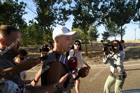 Stock Picture of Santiago Arrospide Sarasola (C, white cap), aka 'Santi Potros', the long-serving leader of the Basque separatist organisation ETA, is accompanied by unidentified relatives and reporters as he leaves the prison of Topas, in Salamanca, Spain, 05 August 2018. Potros, arrested in France in 1987 and later extradited to Spain, has been released after spending 31 of his 70 years in prison. Potros was accused of ordering the placing a car bomb in Barcelona in 1987 which caused the death of a passerby. Spanish prosecutors originally had asked for a 94 years in jail sentence for this and other crimes which in total caused the lives of 40 victims.