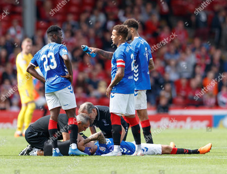 Ryan Jack of Rangers injured on the pitch after sustaining an injury from a challenge from Stevie May of Aberdeen