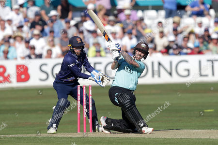 Nic Maddinson hits 6 runs for Surrey as Adam Wheater looks on from behind the stumps during Essex Eagles vs Surrey, Vitality Blast T20 Cricket at The Cloudfm County Ground on 5th August 2018
