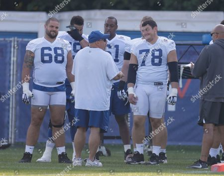 Members of the Indianapolis Colts offensive line including center Ryan Kelly (78) and offensive guard Matt Slauson (68) talk during practice at the NFL team's football training camp in Westfield, Ind