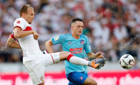 Stuttgart's Holger Badstuber (L) in action against Atletico Madrid's Borja Garces (R) during the friendly soccer match between VfB Stuttgart and Atletico Madrid in Stuttgart, Germany, 05 August 2018.