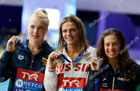 Silver medalist Ruta Meilutyte of Lithuania, gold medalist Yuliya Efimova of Russia and bronze medalist Arianna Castiglioni of Italy, from left to right, pose with their medals after the 100 meters breaststroke women final at the European Swimming Championships in Glasgow, Scotland