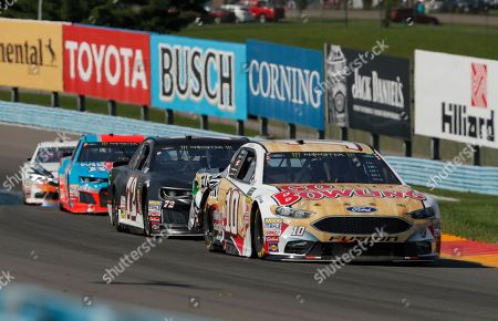 Monster Energy NASCAR Cup Series driver Aric Almirola (10) and Cole Whitt (72) during a NASCAR Cup series auto race, in Watkins Glen, N.Y