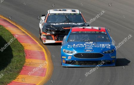 Josh Bilicki (51) and Kasey Kahne (95) during a NASCAR Cup series auto race, in Watkins Glen, N.Y