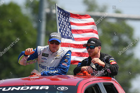 Monster Energy NASCAR Cup Series driver Ty Dillon (L) and Monster Energy NASCAR Cup Series driver Cole Whitt (R) wave to fans prior to the Monster Energy NASCAR Cup Series Go Bowling at The Glen on at Watkins Glen International in Watkins Glen, New York