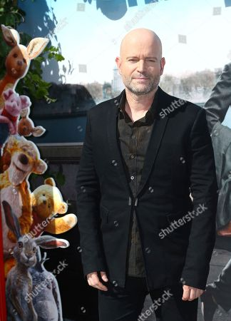 Marc Forster pose for photographers upon arrival at the European Premiere of the film 'Christopher Robin', in a central London cinema