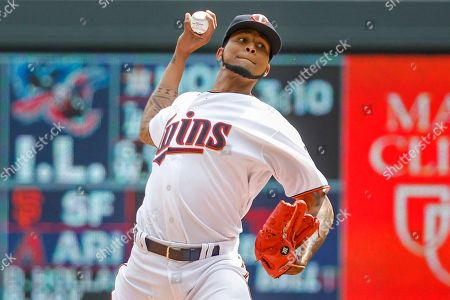 Minnesota Twins starting pitcher Ervin Santana throws to the Kansas City Royals in the first inning of a baseball game, in Minneapolis