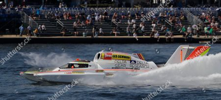 Jimmy Shane,Andrew Tate. Andrew Tate, driving the Les Schwab Tires boat, competes in a heat of the H1 Unlimited Albert Lee Appliance Cup during Seafair weekend, in Seattle