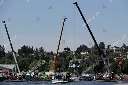 Jimmy Shane,Andrew Tate. The HomeStreet Bank boat is lifted by a crane from the pits to the water for a heat of the H1 Unlimited Albert Lee Appliance Cup during Seafair weekend, in Seattle