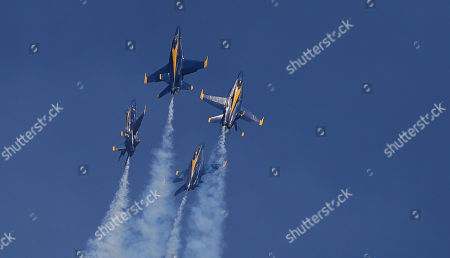Jimmy Shane,Andrew Tate. Members of the U.S. Navy Blue Angels perform in the Seafair Air Show during Seafair weekend, in Seattle