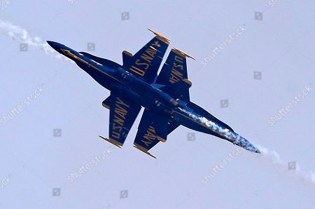 Jimmy Shane, Andrew Tate. Two members of the U.S. Navy Blue Angels make a close pass as they perform in the Seafair Air Show during Seafair Weekend Festival, in Seattle