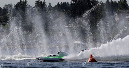 Jimmy Shane, Andrew Tate. Brian Perkins, driving the Paynewest Insurance boat, races during a heat of the H1 Unlimited Albert Lee Appliance Cup during Seafair weekend, in Seattle