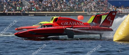 Jimmy Shane, Andrew Tate. J. Michael Kelly, driving the Graham Trucking boat, races against Tom Thompson, driving the J&D Hydraulics boat, during a heat of the H1 Unlimited Albert Lee Appliance Cup during Seafair weekend, in Seattle