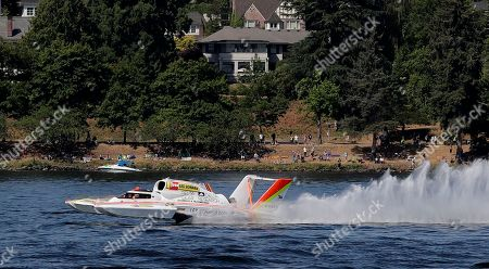 Jimmy Shane, Andrew Tate. Andrew Tate, driving the Les Schwab Tires boat, competes in a heat of the H1 Unlimited Albert Lee Appliance Cup during Seafair weekend, in Seattle