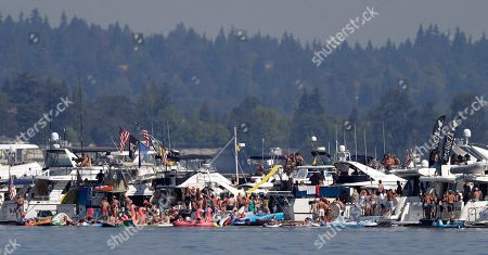 Jimmy Shane, Andrew Tate. Spectators line the log boom during the running of a heat of the H1 Unlimited Albert Lee Appliance Cup during Seafair weekend, in Seattle