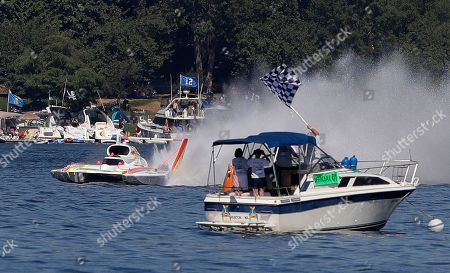 Jimmy Shane, Andrew Tate. Andrew Tate, driving the Les Schwab Tires boat, finishes a heat of the H1 Unlimited Albert Lee Appliance Cup during Seafair weekend, in Seattle