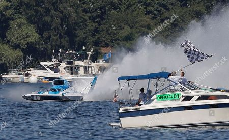 Jimmy Shane, Andrew Tate. Jimmy Shane, driving the HomeStreet Bank boat, finishes a heat of the H1 Unlimited Albert Lee Appliance Cup during Seafair weekend, in Seattle