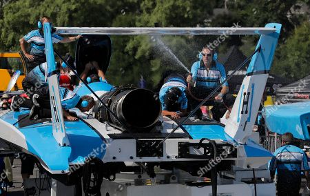 Jimmy Shane, Andrew Tate. A crew member sprays water as heat waves rise during an engine test on the HomeStreet Bank boat, prior to a heat of the H1 Unlimited Albert Lee Appliance Cup during Seafair weekend, in Seattle