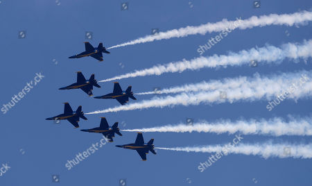 Jimmy Shane, Andrew Tate. Members of the U.S. Navy Blue Angels perform in the Seafair Air Show during Seafair Weekend Festival, in Seattle