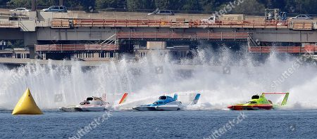 Jimmy Shane, Andrew Tate. Jimmy Shane, center, driving the HomeStreet Bank boat, competes with Andrew Tate, left, driving the Les Schwab Tires boat, and Tom Thompson, right, driving the J&D Hydraulics boat, in a heat of the H1 Unlimited Albert Lee Appliance Cup during Seafair weekend, in Seattle