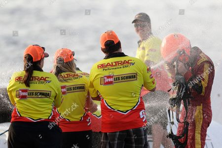 Jimmy Shane, Andrew Tate. Andrew Tate, right, driver of the Les Schwab Tires boat, is sprayed with Champagne after he won the H1 Unlimited Albert Lee Appliance Cup during Seafair weekend, in Seattle