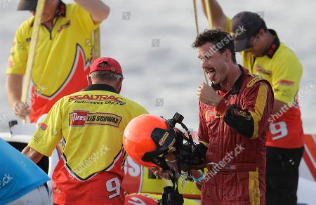 Jimmy Shane, Andrew Tate. Andrew Tate, right, driver of the Les Schwab Tires boat, reacts to being sprayed with Champagne after he won the H1 Unlimited Albert Lee Appliance Cup during Seafair weekend, in Seattle