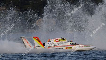 Jimmy Shane, Andrew Tate. Andrew Tate, driving the Les Schwab Tires boat, races in the re-start of the H1 Unlimited Albert Lee Appliance Cup final during Seafair weekend, in Seattle. Tate finished first in the race