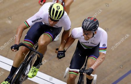 Roger Kluge, left, and Then Reinhardt of Germany compete in the madison men final at the European Cycling Championships in Glasgow, Scotland