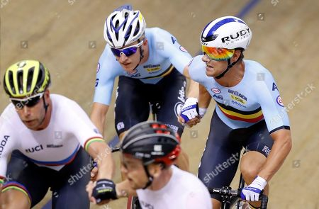 Robbe Ghys and Kenny De Ketele of Belgium, background, and Roger Kluge and Then Reinhardt of Germany, foreground, compete in the madison men final at the European Cycling Championships in Glasgow, Scotland