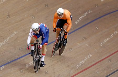 Stock Picture of Philip Hindes of Great Britain, left, and Jeffrey Hoogland of the Netherlands race in a sprint men quarterfinals heat at the European Cycling Championships in Glasgow, Scotland