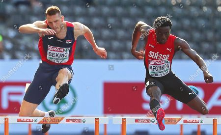 Stock Photo of Emir Bekric (L) of Serbia and Alain-Herve Mfomkpa (R) of Switzerland compete in the men's 400m Hurdles heats at the Athletics 2018 European Championships in Berlin, Germany, 06 August 2018.