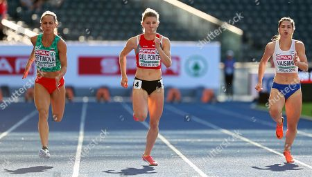 (L-R) Inna Eftimova of Bulgaria, Ajla Del Ponte of Switzerland, and Diana Vaisman of Israel compete in the women's 100m heats at the Athletics 2018 European Championships in Berlin, Germany, 06 August 2018.