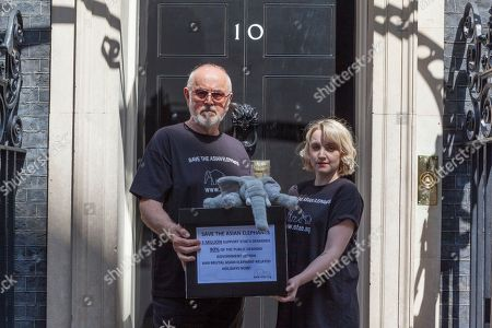 Actor Peter Egan (L) and Evanna Lynch (R), Irish actress, vegan activist, (Luna Lovegood from Harry Potter) hand in a Save the Asian Elephants petition to 10 Downing Street