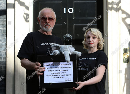 Evanna Lynch (C), Irish actress, vegan activist, (Luna Lovegood from Harry Potter) and actor Peter Egan (R) hand in a Save the Asian Elephants petition to 10 Downing Street