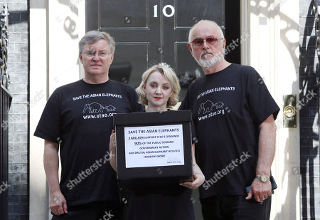 Duncan McNair KHS (L) CEO of Save the Asian Elephants (stae) and Evanna Lynch (C), Irish actress, vegan activist, (Luna Lovegood from Harry Potter) and actor Peter Egan (R) hand in a Save the Asian Elephants petition to 10 Downing Street