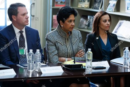 Donald Trump, Neil Gorsuch, Anthony Kennedy, Doug McMillon, Indra Nooyi, Dina Powell. From left, Wal-Mart CEO Doug McMillon, Pepsi CEO Indra Nooyi, and Dina Powell, President Donald Trump's senior counselor for economic initiatives listen during a meeting with business leaders in the State Department Library of the Eisenhower Executive Office Building on the White House complex in Washington. With Nooyi exiting PepsiCo as its longtime chief executive, the circle of CEOs in the Fortune 500 is losing one of its highest profile women. Nooyi has been with PepsiCo Inc. for 24 years and held the top job for 12