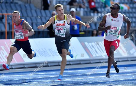 Portugal's Carlos Nascimento, right, competes in the 100 meter first Round race beside Germany's Julian Reus, center, and Czech Republic's Jakub Vadlejch, left, at the European Athletics Championships in Berlin, Germany