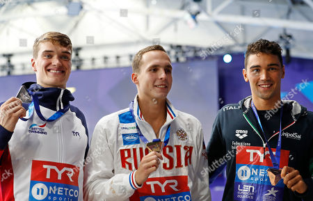 Silver medalist James Wilby of Great Britain, gold medalist Anton Chupkov of Russia and Luca Pizzini of Italy, from left to right, pose with their medals after the 200 meters breaststroke men final at the European Swimming Championships in Glasgow, Scotland