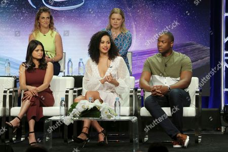 """Jennie Snyder Urman, Amy Rardin, Melonie Diaz, Madeleine Mantock, Ser'Darius Blain. Executive producers Jennie Snyder Urman, from back row left, Amy Rardin, and and from front row left, Melonie Diaz, Madeleine Mantock and Ser'Darius Blain participate in the """"Charmed"""" panel during the CW Television Critics Association Summer Press Tour at The Beverly Hilton hotel, in Beverly Hills, Calif"""