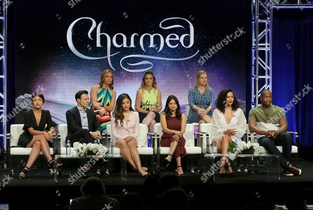 """Stock Photo of Jessica O'Toole, Jennie Snyder Urman, Amy Rardin, Ellen Tamaki, Rupert Evans, Sarah Jeffery, Melonie Diaz, Madeleine Mantock, Ser'Darius Blain. Executive producers Jessica O'Toole, from back row left, Jennie Snyder Urman, Amy Rardin, and from front row left, Ellen Tamaki, Rupert Evans, Sarah Jeffery, Melonie Diaz, Madeleine Mantock and Ser'Darius Blain participate in the """"Charmed"""" panel during the CW Television Critics Association Summer Press Tour at The Beverly Hilton hotel, in Beverly Hills, Calif"""