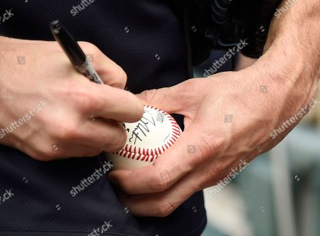 New York Yankees relief pitcher David Robertson signs a baseball before a baseball game against the Chicago White Sox, in Chicago