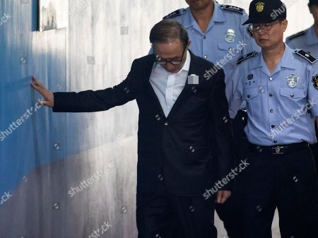 Former President Lee Myung-bak arrives at the Seoul Central District Court in Seoul South Korea, 07 August 2018. Myung-bak is standing trial on corruption and embezzlement charges. It marks Lee's first court appearance since he returned to jail on Aug. 3 after five days of treatment for his chronic illnesses at a local hospital.