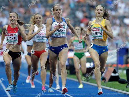 Switzerland's Selina Buechel, Britain's Lynsey Sharp and Ukraine's Olha Lyakhova, from left, finish a women's 800-meter heat at the European Athletics Championships at the Olympic stadium in Berlin, Germany