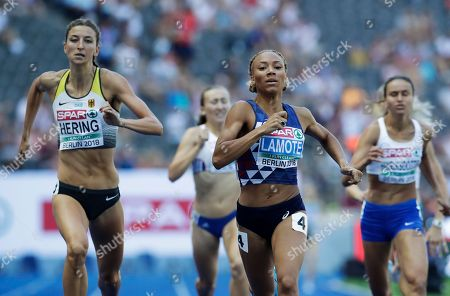 Germany's Christina Hering and France's Renelle Lamote, from left, finish a women's 800-meter heat at the European Athletics Championships at the Olympic stadium in Berlin, Germany