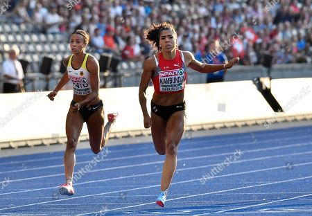 Switzerland's Mujinga Kambundji, right, and Germany's Tatjana Pinto cross the line of a women's 100-meter semifinal at the European Athletics Championships in Berlin, Germany