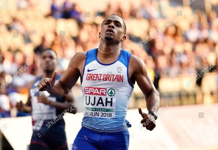 Britain's Chijindu Ujah checks his time after a men's 100-meter semifinal at the European Athletics Championships in Berlin, Germany