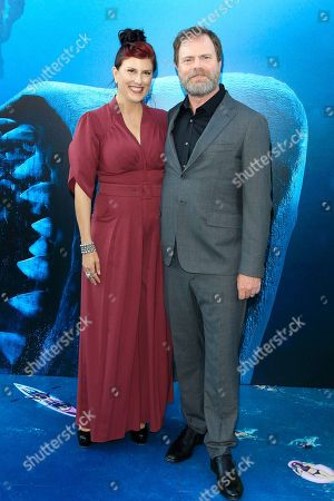 US actor/cast member Rainn Wilson (R) and his wife Holiday Reinhorn (L) attend the US premiere of 'The Meg' at the TCL Chinese Theatre IMAX in Hollywood, Los Angeles, California, USA, 06 August 2018 (issued 07 August 2018). The movie opens in the US on 10 August.